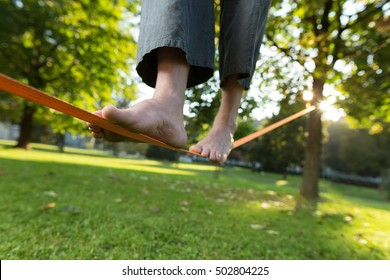 Slackline. Close up of foots on the rope