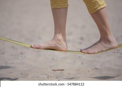 Slackline on the beach on a background of sand