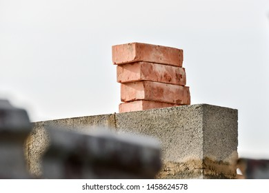 Slag stone and red brick on the wall and building construction.