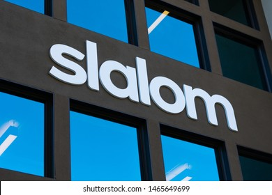 Slalom sign on facade of Slalom Consulting business and technology consulting firm office in Silicon Valley - Palo Alto, California, USA - July 30, 2019