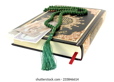 slammed Quran with Pakistani currency before light background