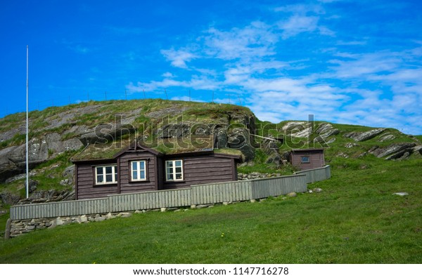 Slanted old cottage on the mountain.