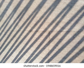 Slanted shadow lines on the ground.