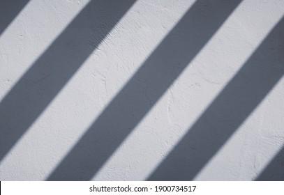 slanted shadow stripes on white wall