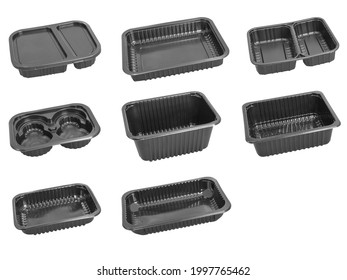Slanted view different types of black trays isolated on white background - black plastic trays - trays food - rectanguler trays and tray with cap