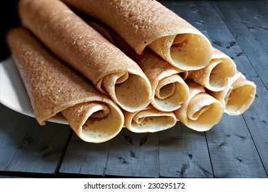 slapjack, pancakes, rolled and laid the slide on the plate