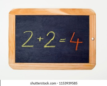 a slate with a arithmetic problem and a right sum