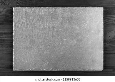 Slate blackboard on wooden background