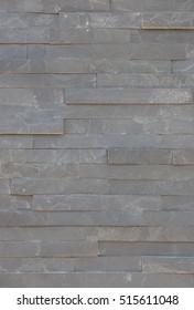 Slate Gray Brick Wall.  Closeup of an irregular slate wall with pattern and texture.