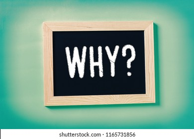 Slate on blue background with the word Why ? - Business concept