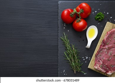 Slate plate with food on black background