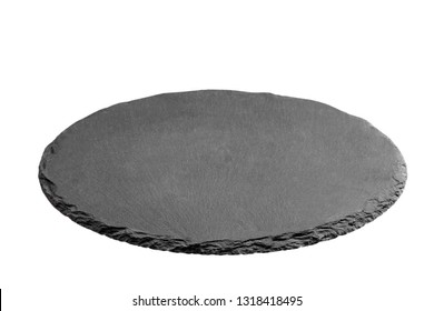 Slate plate on table. black slate stone isolated on white background. copy space.