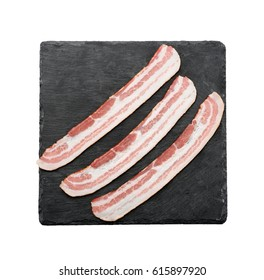 Slate plate with strips of bacon on white background