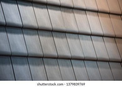 Slate roof tiles background. Natural photo.