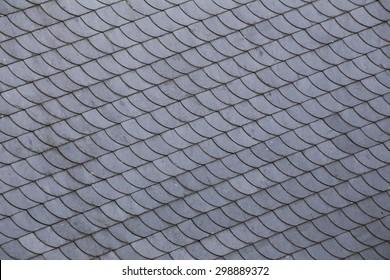 Slate roof tiles with a diagonal arrangement.