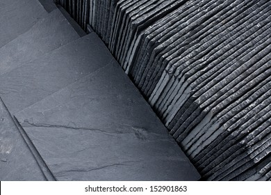 Slate roofing tiles in a pallet ready for sale sale as a construction material at a building suppliers