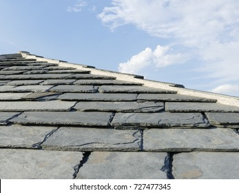 A slate tiled roof. on a traditional house in Corsica, France