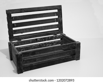 Slatted Vent Box with Focus to Interior Base and Lid, with Age Related Staining and Marks of the Rough Wooden Chest.