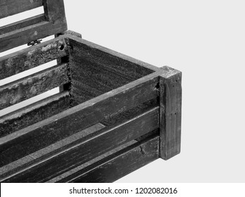 A Slatted Vent Box with Front Focus and Age Related Staining and Marks of the Rough Wooden Chest.