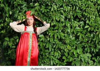 Slav in traditional dress ivy wall tree