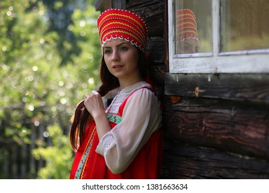 Slav woman in traditional dress wooden wall