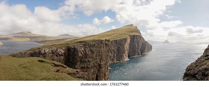 Trælanípa Slave Cliff and Leitisvatn Lake mountain landscapes in the Faroe Islands of Denmark.