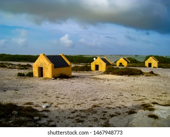 Slave huts built on the southwest coast of Bonaire in the 1850s near Bonaire's Salt Lake. Most slaves worked the salt flats, while others were forced to cultivate maize or cut dyewood.