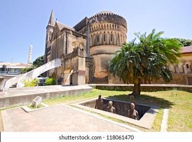 Slave Market Memorial with Church in the Background in Stone Town on Zanzibar Island - Tanzania