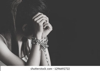 Slave woman hands tied up with chain, Violence against women, Human rights violations, Human trafficking, International Women's Day.