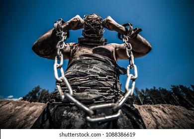 Slavery. The slave is in chains.
