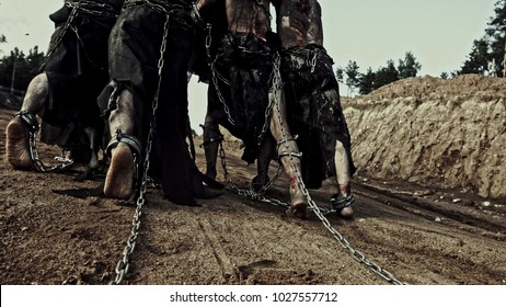 Slavery. Wounded slaves in chains and fetters.