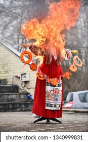 Slavic holiday end of winter. The big Shrovetide doll burns as a symbol of the approach of spring. Black smoke and bright flames