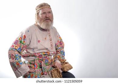 Slavic man in a beautiful national painted shirt