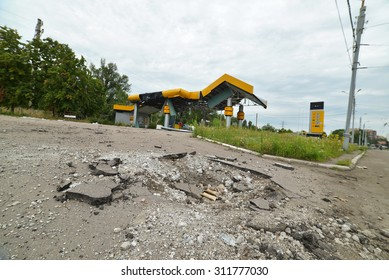 SLAVJANSK, UKRAINE - JULY 15, 2014: the result of the shelling of a peaceful town militias. In the foreground a funnel from a mine explosion.