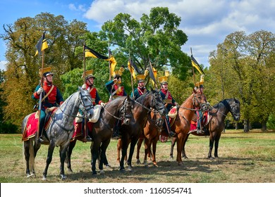 Slavkov u Brna, Czech Republic - August 11, 2018: Slavkov-Austerlitz castle historical reenactment. Procession of horsemen in historical uniform from Napoleon Bonaparte period in great court of castle