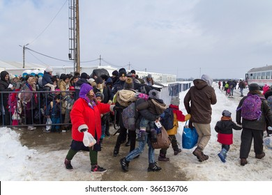 SLAVONSKI BROD, CROATIA - JANUARY 7, 2016 : Immigrants and refugees from Middle East and North Africa in transit through Croatia entering the train in transit center.