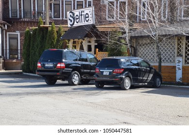 Slavyansk-on-Kuban, Russia - March 19, 2018: Land Cruiser Prado from Toyota, and Mercedes b200. The car is parked near the cafe.