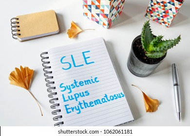 SLE Systemic Lupus Erythematosus written in notebook on white table