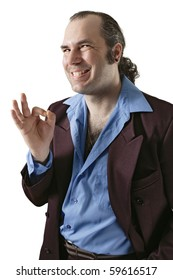 A sleazy car salesman, Con man, or pimp, wearing a retro suit and smiling with a large cheesy grin.