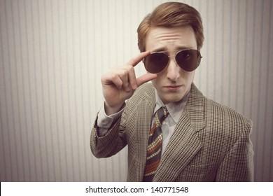 Sleazy Retro Businessman, on vintage wallpaper background