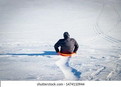 Sledding on Snowy Wisconsin Hill