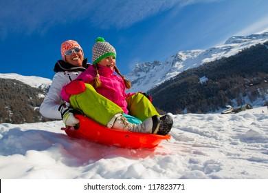 Sledding, winter fun, snow, family sledding at winter time
