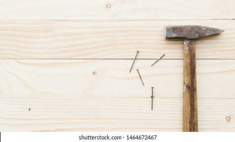 Sledgehammer with nails on table