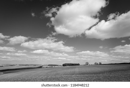 Sledmere, Yorkshire, UK. Ploughed farmland across the rolling Wolds  under a blue sky in early autumn near Sledmere, Yorkshire, UK.