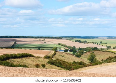 Sledmere, Yorkshire, UK. Ploughed fields across the rolling Wolds  under a blue sky in early autumn near Sledmere, Yorkshire, UK.