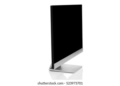 Sleek modern computer display with blank black screen, front side view and isolated on white background with reflection
