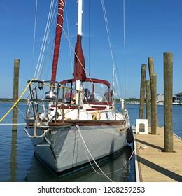 Sleek sailboat docked on Harbor Island in Wrightsville Beach, North Carolina