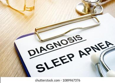 Sleep apnea diagnosis on a clipboard.