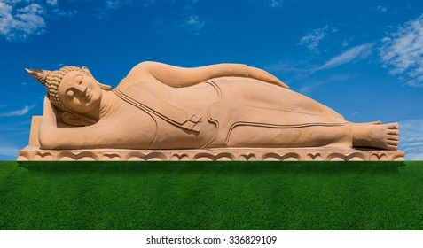 Sleep Buddha sculpture with blue sky