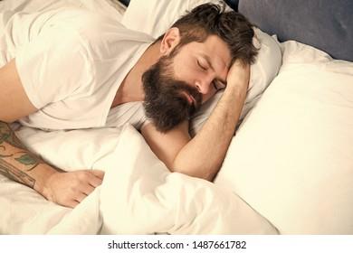 Sleep disorders concept. Man bearded hipster having problems with sleep. Guy lying in bed try to relax and fall asleep. Relaxation techniques. Violations of sleep and wakefulness. Need some rest.